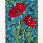 Two poppies on blue