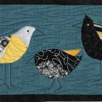 3 silly black and yellow birds